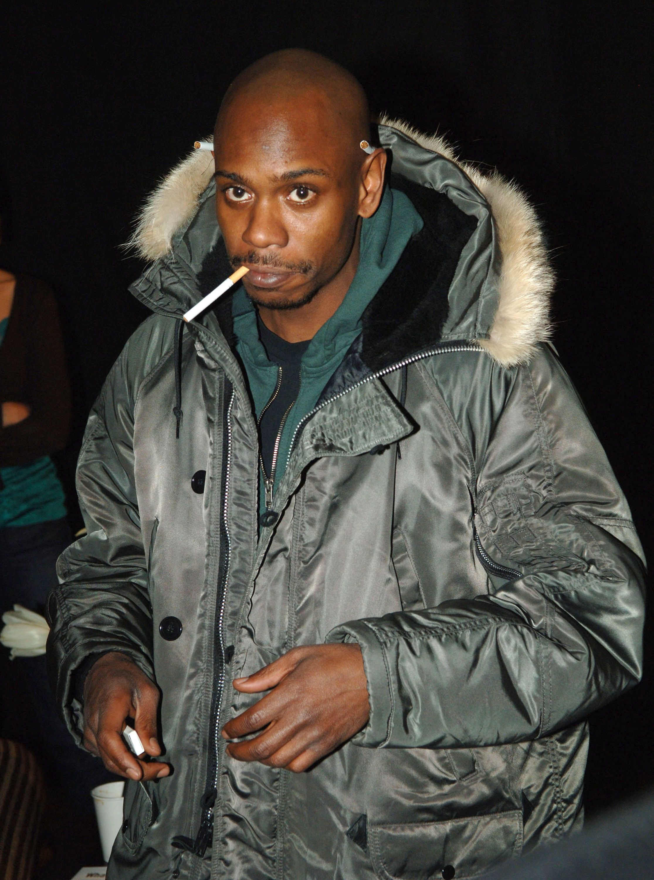 Dave Chappelle smoking a cigarette (or weed)