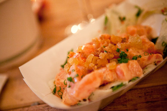 Fennel salad topped with Asian-inspired salmon crudo, sesame oil, tempura bits, and spicy mayonnaise