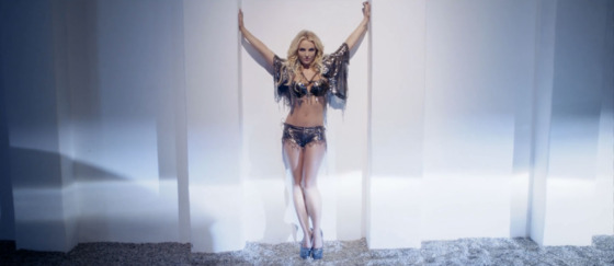 Custom Michael Schmidt bra, shorts, and cape; Christian Louboutin heels; all jewelry by Loree Rodkin