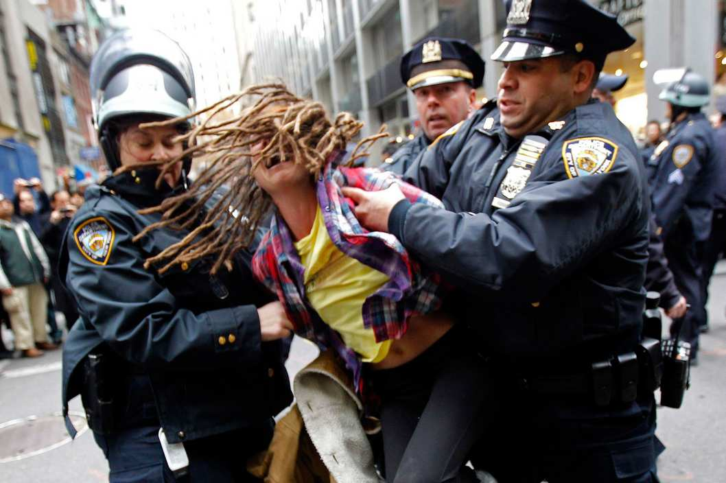 "An Occupy Wall Street demonstrator is arrested by New York City Police during what protest organizers called a ""Day of Action"" in New York November 17, 2011. Hundreds of Occupy Wall Street protesters marched through New York's financial district toward the stock exchange on Thursday to protest economic inequality at the heart of American capitalism. REUTERS/Mike Segar (UNITED STATES - Tags: BUSINESS CIVIL UNREST)"