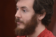 James Holmes, Aurora theater shooting suspect, sits in the courtroom during his arraignment in Centennial, Colo., on Tuesday, March 12, 2013. Judge William Blair Sylvester entered a not guilty plea on behalf of James Holmes on Tuesday after the former graduate student's defense team said he was not ready to enter one.