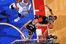 Brook Lopez #11 of the Brooklyn Nets grabs a rebound against the Philadelphia 76ers at the Wells Fargo Center on December 20, 2013 in Philadelphia, Pennsylvania.