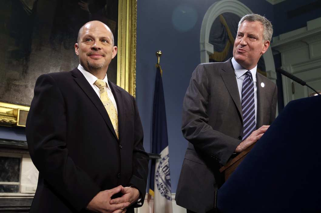 Mayor Bill de Blasio and President of the United Federation of Teachers Michael Mulgrew announce the deal at City Hall on May 1, 2014.