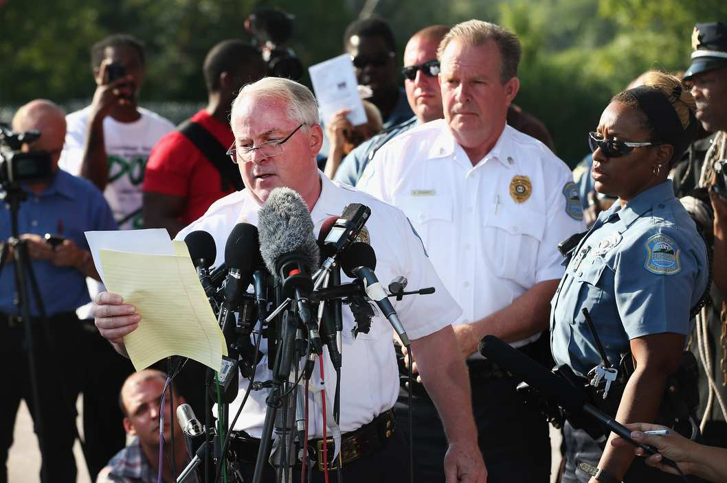FERGUSON, MO - AUGUST 15:  Standing in the parking lot of a gas station which was burned during rioting, Ferguson Police Chief Thomas Jackson announces the name of the Ferguson police officer responsible for the August 9, shooting death of teenager Michael Brown on August 15, 2014 in Ferguson, Missouri. The officer was identified as Darren Wilson, a six year veteran of the police department. Brown's killing sparked several days of violent protests in the city.  (Photo by Scott Olson/Getty Images)