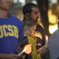 LOS ANGELES , CA - MAY 26:  Students of UCSB and UCLA mourn at a candlelight vigil at UCLA for the victims of a killing rampage over the weekend near UCSB on May 26, 2014 in Los Angeles, California. According to reports, 22 year old Elliot Rodger, son of assistant director of the Hunger Games, Peter Rodger, began his mass killing near the University of California, Santa Barbara by stabbing three people to death in an apartment. He then went on to shooting  and running down people while driving his BMW until crashing with a self-inflicted gunshot wound to the head. Officers found three legally-purchased guns registered to him inside the vehicle. Prior to the murders, Rodger posted YouTube videos declaring his intention to annihilate the girls who rejected him sexually and others in retaliation for his remaining a virgin at age 22. Seven people died, including Rodger, and seven others were wounded.  (Photo by David McNew/Getty Images)
