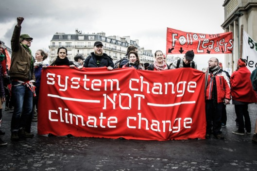 Thousands of people on a march for global climate justice in Paris