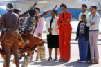 a 146x97 Michelle Obama Arrived in Botswana Wearing a Red Pantsuit