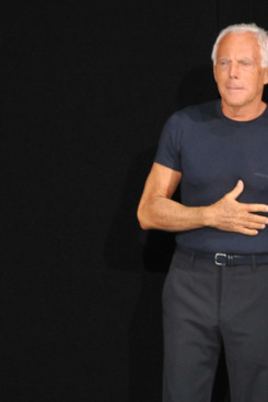 Italian fashion designer Giorgio Armani acknowledges the audience at the end of the Emporio Armani Spring-Summer 2012 Menswear collection on June 19, 2011 during the Men's fashion week in Milan.  AFP PHOTO / GIUSEPPE CACACE (Photo credit should read GIUSEPPE CACACE/AFP/Getty Images)
