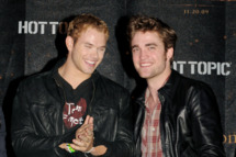 "LOS ANGELES, CA - NOVEMBER 06:  Actors Kellan Lutz (L) and Robert Pattinson appear onstage at Summit's ""The Twilight Saga: New Moon"" Cast Tour at Hollywood and Highland on November 6, 2009 in Los Angeles, California.  (Photo by Kevin Winter/Getty Images) *** Local Caption *** Kellan Lutz;Robert Pattinson"