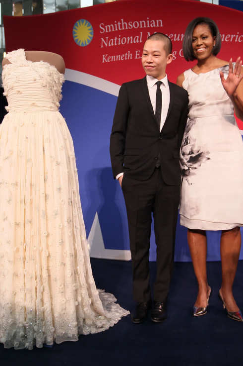 WASHINGTON - MARCH 09:  First lady Michelle Obama and inaugural dress designer Jason Wu look at the inaugural gown she wore to the inaugural balls and is now on display at the Smithsonian Museum of American History on March 9, 2010 in Washington, DC. Mrs. Obama continues a long tradition of first lady's who have donated their inaugural gown to be on display at the Smithsonian.  (Photo by Mark Wilson/Getty Images) *** Local Caption *** Jason Wu;Michelle Obama
