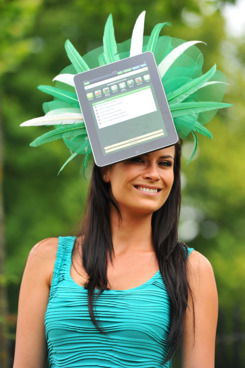 A race-goer wears a hat with an iPad design on the second day of the annual Royal Ascot horse racing event near Windsor, west of London, in Berkshire, on June 15, 2011. The five-day meeting is one of the highlights of the global horse racing calendar. Horse racing has been held at the famous Berkshire course since 1711 and tradition is a hallmark of the meeting. Top hats and tails remain compulsory in parts of the course while a daily procession of horse-drawn carriages brings the Queen to the course. AFP PHOTO/Carl de Souza (Photo credit should read CARL DE SOUZA/AFP/Getty Images)