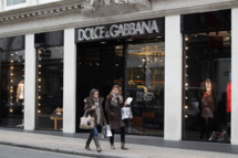 LONDON, ENGLAND - JANUARY 24:  People walk by a Dolce & Gabbana store window on Bond Street on January 24, 2011 in London, England. Despite the expected retail slump, sales of luxury goods are booming, with many companies posting large profits.  (Photo by Dan Kitwood/Getty Images)