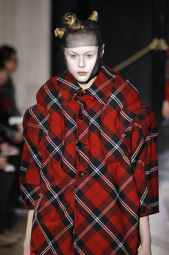 A model presents a creation by Japanese designer Rei Kawakubo for Comme des Garcons during the autumn-winter 2010/2011 ready-to-wear collection show on March 6, 2010 in Paris. AFP PHOTO/Patrick Kovarik (Photo credit should read PATRICK KOVARIK/AFP/Getty Images)