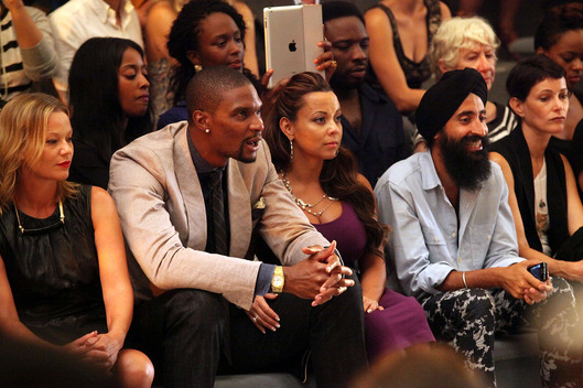 NEW YORK, NY - SEPTEMBER 09:  (L-R) NBA player Chris Bosh, Adrienne Bosh and designer Waris Ahluwalia attend the Cynthia Rowley Spring 2012 fashion show during Mercedes-Benz Fashion Week at The Stage at Lincoln Center on September 9, 2011 in New York City.  (Photo by Astrid Stawiarz/Getty Images for Mercedes-Benz Fashion Week)