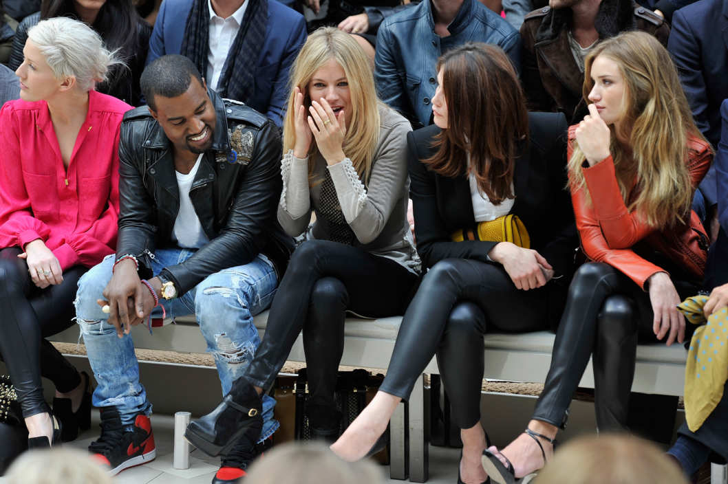 LONDON, ENGLAND - SEPTEMBER 19:  Kanye West, Sienna Miller, Gemma Arterton and Rosie Huntington-Whitley attend the Burberry Spring Summer 2012 Womenswear Show at Kensington Gardens on September 19, 2011 in London, England.  (Photo by Gareth Cattermole/Getty Images for Burberry)
