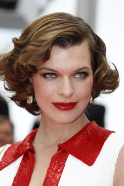 "Actress Milla Jovovich poses on the red carpet before the screening of ""La Conquete"" (The Conquest) presented out of competition at the 64th Cannes Film Festival on May 18, 2011 in Cannes.   AFP PHOTO / FRANCOIS GUILLOT (Photo credit should read FRANCOIS GUILLOT/AFP/Getty Images)"