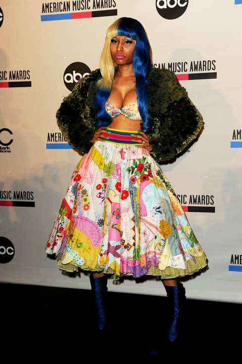 LOS ANGELES, CA - OCTOBER 11:  Recording artist Nicki Minaj poses onstage during the 2011 American Music Awards Nominees Press Conference at JW Marriott Los Angeles at L.A. LIVE on October 11, 2011 in Los Angeles, California.  (Photo by Kevin Winter/Getty Images  for DCP)