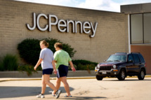 Pedestrians walk past a J.C. Penney Co. Inc. store in Peru, Illinois, U.S., on Sunday, Aug. 7, 2011. J.C. Penney Co. Inc. is scheduled to release second quarter earnings on August 12. Photographer: Daniel Acker/Bloomberg via Getty Images