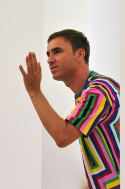 Belgian fashion designer Raf Simons acknowledges the audience at the end of Jil Sander Spring-Summer 2012 ready-to-wear collection on September 24, 2011 during the Women's Mialn fashion week.  AFP PHOTO / GIUSEPPE CACACE (Photo credit should read GIUSEPPE CACACE/AFP/Getty Images)