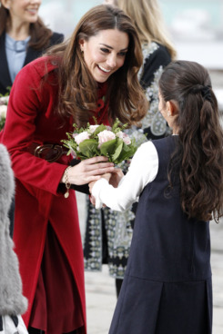 COPENHAGEN, DENMARK - NOVEMBER 2:  Catherine, Duchess of Cambridge is presented with a bouquet of flowers as she arrives for a visit to the UNICEF Emergency Supply Centre on November 2, 2011 in Copenhagen, Denmark. Catherine, Duchess of Cambridge and Prince William, Duke of Cambridge visited the centre to view efforts to distribute emergency food and medical supplies to eastern Africa where severe food shortages are affecting more than 13 million people. (Photo by Phil Noble - WPA Pool/Getty Images)