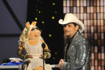 NASHVILLE, TN - NOVEMBER 09:  Miss Piggy and Brad Paisley speak onstage at the 45th annual CMA Awards at the Bridgestone Arena on November 9, 2011 in Nashville, Tennessee.  (Photo by Rick Diamond/Getty Images)