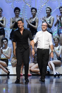 (FILES) This file picture taken on September 25, 2011 during the Milan's women fashion week shows designers Stefano Gabbana (L) and Domenico Dolce acknowledging the audience at the end of the Dolce & Gabbana Spring-Summer 2012 ready-to-wear collection. Italian media said on November 23, 2011 that fashion house duo Dolce & Gabbana may stand trial for alleged tax fraud after Italy's highest court the same day overturned a judge's decision to throw the case against them out. AFP PHOTO / FILES /FILIPPO MONTEFORTE (Photo credit should read FILIPPO MONTEFORTE/AFP/Getty Images)