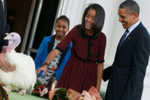 WASHINGTON, DC - NOVEMBER 23:  U.S. President Barack Obama is flanked by his daughters Sasha (L) and Malia (R) after pardoning 'Liberty', a 19-week old, 45-pound turkey at the North Portico of the White House November 23, 2011 in Washington, DC. The Presidential pardon of a turkey has been a long time Thanksgiving tradition that dates back to the Harry Truman administration. (Photo by Mark Wilson/Getty Images)