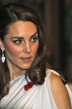 Catherine, Britain's Duchess of Cambridge (C) talks to people at a dinner reception in aid of the National Memorial Arboretum Appeal at St James's Palace, in London, on November 10, 2011. The Appeal was launched in April 2009 by its Patron, The Duke of Cambridge, to develop the Arboretum into a world-renowned centre for Remembrance and to ensure that there are necessary facilities for the 300,000 visiting families, servicemen and women, veterans and members of the public each year.  AFP PHOTO/WPA POOL/ LEFTERIS PITARAKIS (Photo credit should read LEFTERIS PITARAKIS/AFP/Getty Images)
