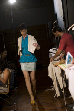 BARCELONA, SPAIN - JULY 14:  Assistants iron and sew as A model goes into backstage after the Montse Liarte catwalk show during the 080 Barcelona Fashion week on July 14, 2011 in Barcelona, Spain.  (Photo by David Ramos/Getty Images)