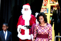 "First Lady Michelle Obama responds to questions from children after she  read ""Twas the Night Before Christmas"" to children and their families at the National Chidlren's Hospital."