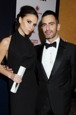 LONDON, ENGLAND - NOVEMBER 28:  (EMBARGOED FOR PUBLICATION IN UK TABLOID NEWSPAPERS UNTIL 48 HOURS AFTER CREATE DATE AND TIME. MANDATORY CREDIT PHOTO BY DAVE M. BENETT/GETTY IMAGES REQUIRED)  Designer Brand award winner Victoria Beckham (L) and designer Marc Jacobs pose at the British Fashion Awards 2011 at The Savoy Hotel on November 28, 2011 in London, England.  (Photo by Dave M. Benett/Getty Images)