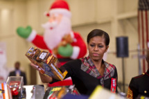US First Lady Michelle Obama delivers toys and gifts donated by Executive Office staff to the Marine Corps? Toys for Tots campaign at Joint Base Anacostia-Bolling in Washington,DC on December 16, 2011.