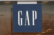 A sign hangs above the entrance of a GAP store.