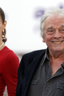 US photographer David Bailey (R)  smiles as he arrives for a charity gala dinner at Kensington Palace in London on June 9, 2011.