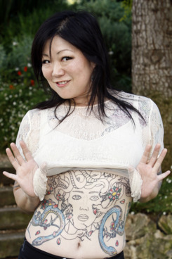 "US fashion designer, actress, author, and recording artist Margaret Cho poses during a photocall to promote her new release ""Cho Dependent""  on October 3, 2011 in Cannes."