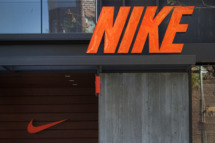 Nike Inc. signage is displayed outside of a store at the Third Street Promenade outdoor mall in Santa Monica, California, U.S, on Monday, Dec. 5, 2011.