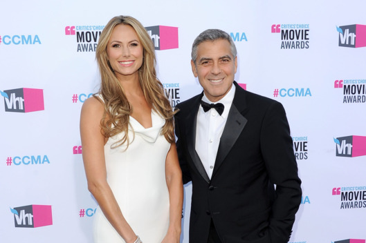 Actor/Director George Clooney (R) and actress Stacy Keibler arrive at the 17th Annual Critics' Choice Movie Awards.