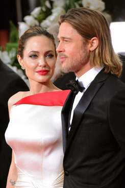 Actress Angelina Jolie (L) and actor Brad Pitt arrive at the 69th Annual Golden Globe Awards