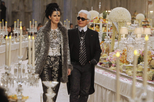 Stella Tennant and Karl Lagerfeld walk on the catwalk at the Chanel Paris-Bombay Show at Grand Palais on December 6, 2011 in Paris, France.