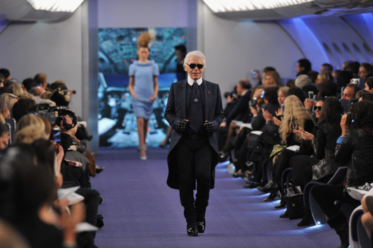 Karl Lagerfeld acknowledges the applause of the audience after the Chanel Haute-Couture Spring / Summer 2012 Show.