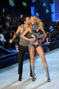 Adam Levine of Maroon 5 performs with Model Anne Vyalitsina