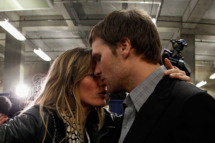 Tom Brady #12 of the New England Patriots is comforted by his wife Gisele Bundchen after losing to the New York Giants by a score of 21-17 in Super Bowl XLVI .