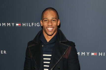 New York Giants wide receiver Victor Cruz poses backstage at the Tommy Hilfiger Presents Fall 2012 Men's Collection show