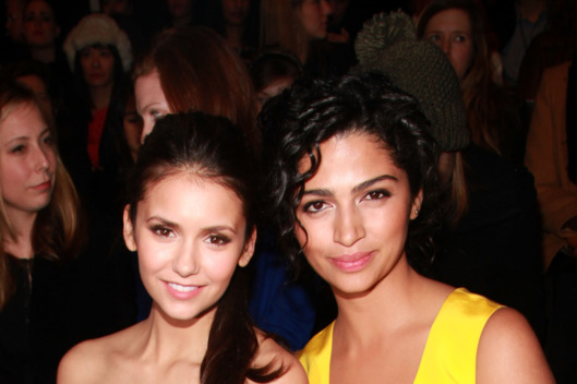 (L-R) Actresses Nina Dobrev and Camila Alves attend the Monique Lhuillier Fall 2012 fashion show