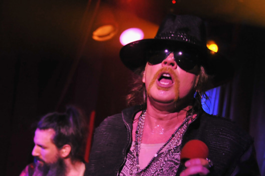 Axl Rose of Guns N' Roses perform during the DeLeon Tequila with Nur Khan Electric Sessions Presents The DeLeon Rock Lounge featuring Guns N' Roses>> at the Hiro Ballroom at The Maritime Hotel on February 16, 2012 in New York City.