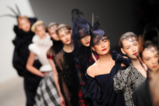 Models present creations by designer Corrie Nielsen at London Fashion Week in London on February 17, 2012.