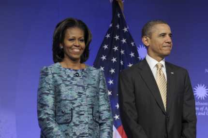 President Barack Obama and first lady Michelle Obama arrive to attend a groundbreaking ceremony at the construction site of the Smithsonian National Museum of African American History and Culture in Washington, Wednesday, Feb. 22, 2012.