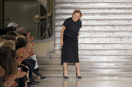 Italian designer Miuccia Prada acknowledges the public following the Miu Miu Autumn/Winter 2011-2012