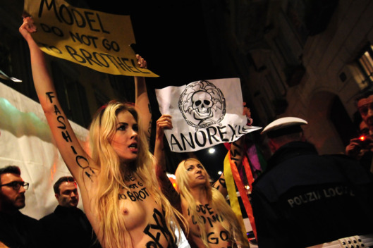 Members of the radical feminist group Femen protest at the entrance of the Versace Fall-winter 2012-2013 show on February 24, 2012 during the Women's fashion week in Milan.    AFP PHOTO / GIUSEPPE CACACE (Photo credit should read GIUSEPPE CACACE/AFP/Getty Images)