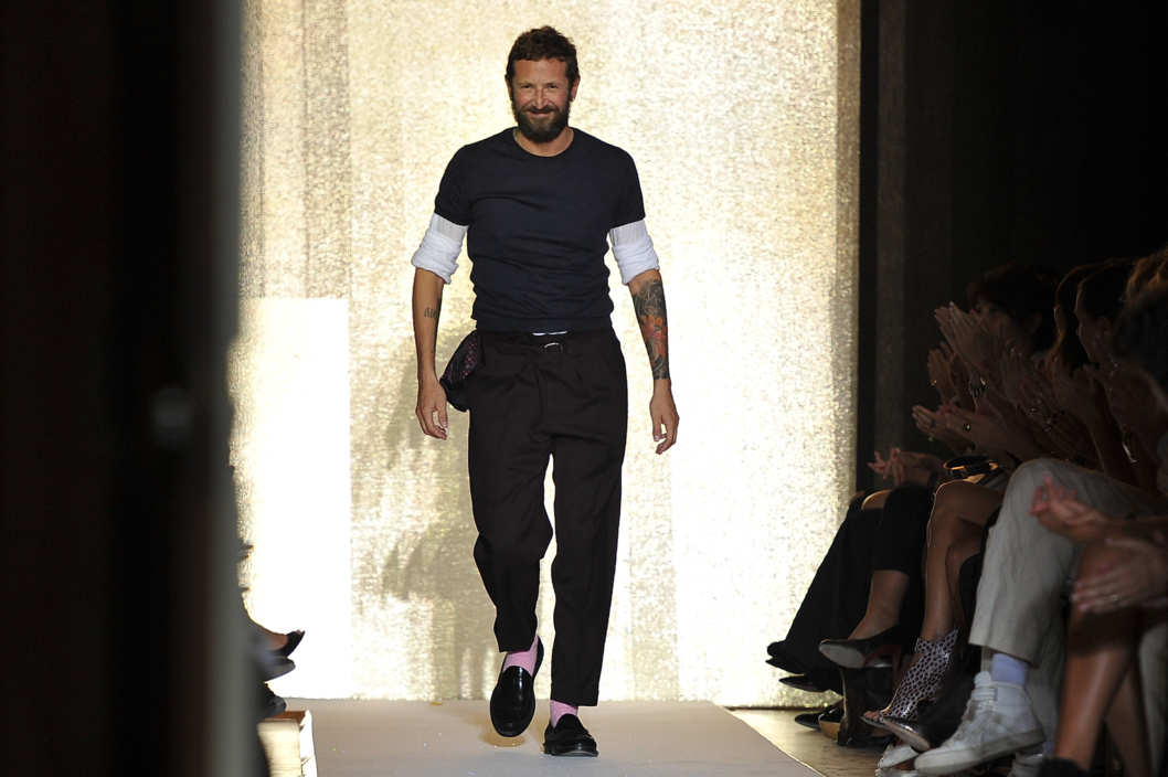 Designer Stefano Pilati acknowledges the applause of the audience after the Yves Saint Laurent Ready to Wear Spring / Summer 2012 show during Paris Fashion Week  on October 3, 2011 in Paris, France.